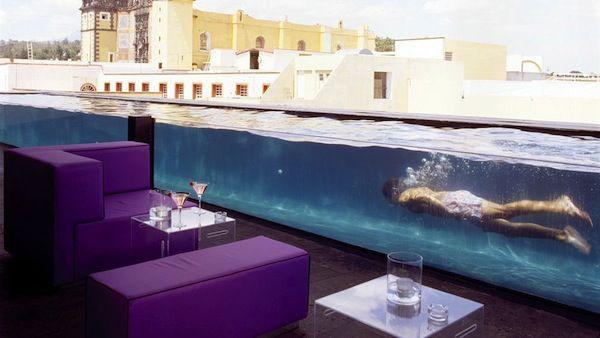 Grupo corbalan acuarios piscinas vidrio acuario for Hotel con piso de vidrio sobre el mar